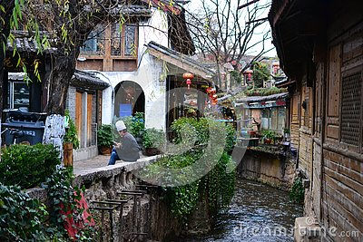 Alley and streets in Old town of Lijiang, Yunnan, China with traditional chinese architecture