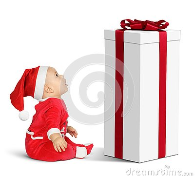 surprised Little baby Santa Claus with big Christmas gift, as gnome