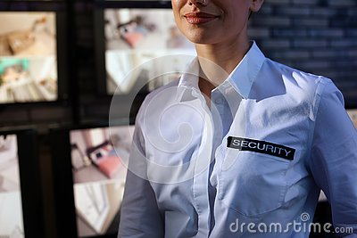 Female security guard wearing uniform at workplace