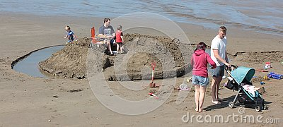 stock image of happy families on the beach broad haven august 2018