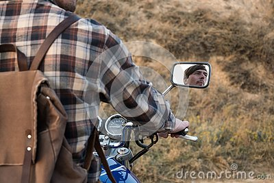 Portrait of young male biker in summer day