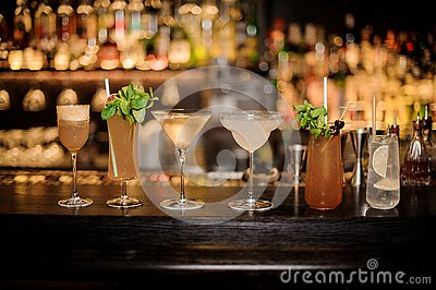 Set of classic cocktails: Dirty Martini, Sherry Cobbler, Brandy Crusta, Margarita, Cobras Fang and Tom Collins