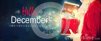 Hello December message with Santa opening a gift box