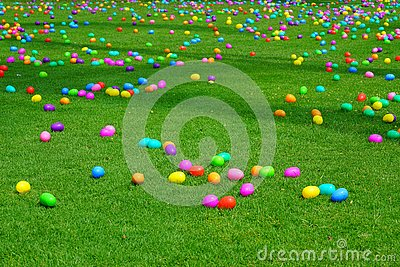 An Easter egg hunt with plastic eggs on a green lawn