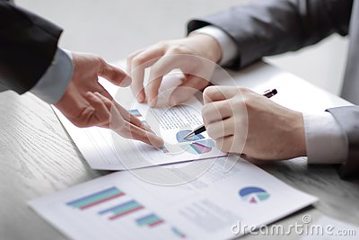 stock image of business man and partner are proposing business plans to young e
