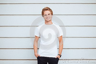 Young man wearing blank tshirt and blue jeans