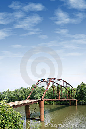 Old Iron And Wooden Bridge With Large Cloudy Sky