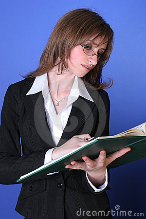 Young business woman reading a green file