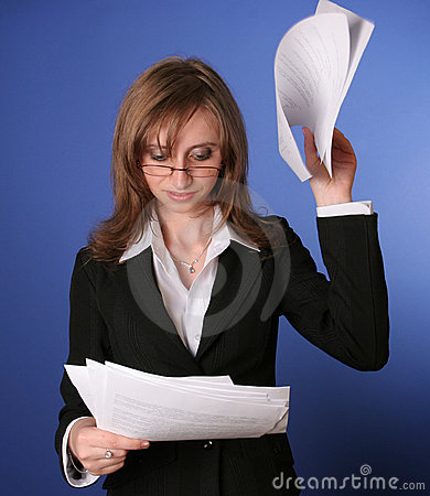 Business woman reading impatiently a file