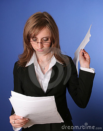 Business woman reading a file