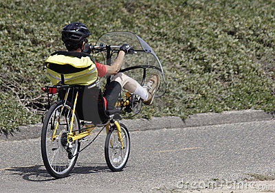 Man riding a unique bike with a windshield