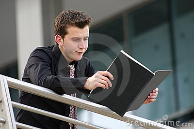 Business man bored - reading aris