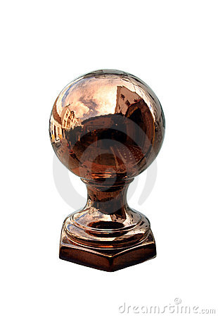 Heavy copper or brass globe on a wall outside a restaurant