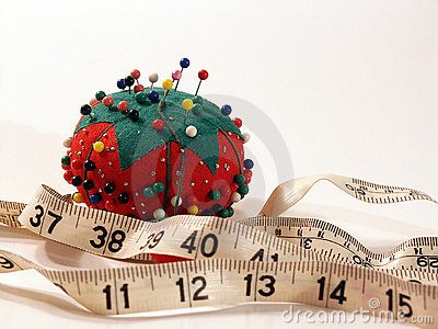 Pin cushion and measuring tape
