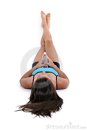 Beautiful Teen Girl Laying On Floor Holding Bottle Of Water