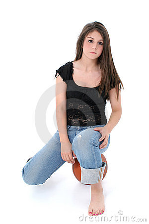 Beautiful Teen Girl In Jeans Sitting On Basket Ball Over White