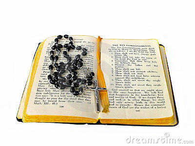 Rosary beads open bible