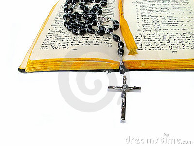 Rosary beads on bible
