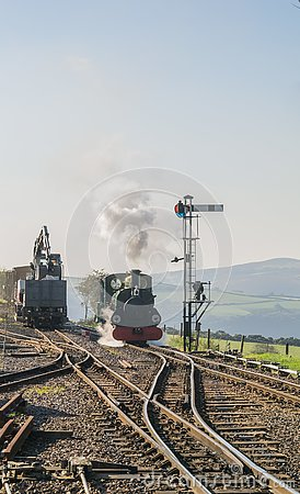 Front view of approaching steam engine `Blanche` at Woody Bay station