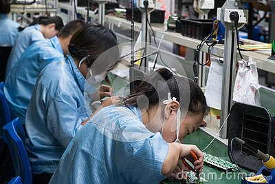 stock image of asian chinese electronics factory workers female industry manufacturing assembly line