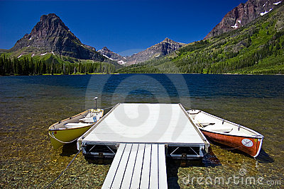 Mountain lake with canoes and dock