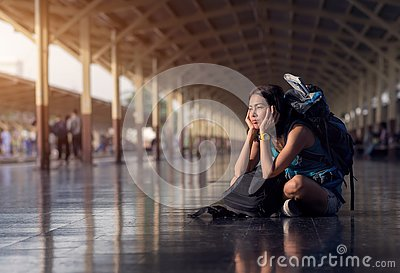 Asia woman with bag backpack and sitting bored wait a time for t