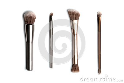 Four shiny bronze- and silver-coloured makeup brushes for applying powder, eyeshadow, eyeliner, bronzer and highlighter
