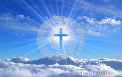 Religious cross over cumulus clouds illuminated by the rays of holy radiance, concept.