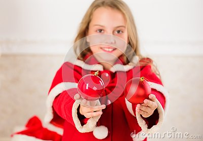 Getting child involved decorating. How to decorate christmas tree with kid. Girl smiling face hold balls ornaments white