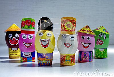 Easter eggs. Happy Day Bright Easter! Orthodox Easter holiday. Easter eggs with smile in hats. Closeup.