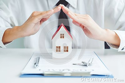 The concept of home ownership Sale agent Insurance Home protection concept