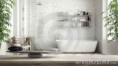 Wooden vintage table or shelf with stone balance, over blurred vintage bathroom with bathtub and shower, feng shui, zen concept ar