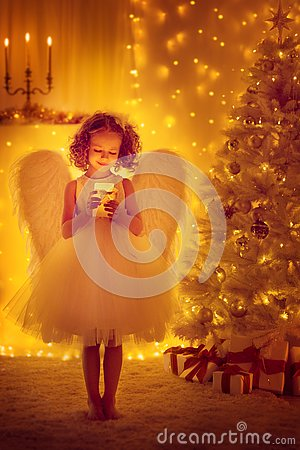 Christmas Angel Child with Wings hold Lighting Candle, Xmas Tree