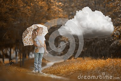 A girl walking the rainy cloud at autumn time on the orange background