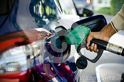 Man filling up gas in his car