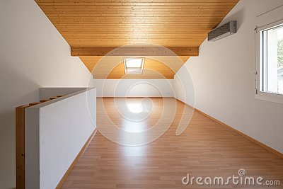 Large attic with wooden floors and exposed beams
