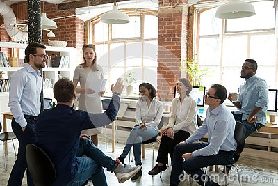 Male worker raise hand asking question at office teambuilding