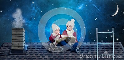 Two brothers sit on Christmas night on the roof and read a book with fairy tales.In anticipation of Christmas miracles.