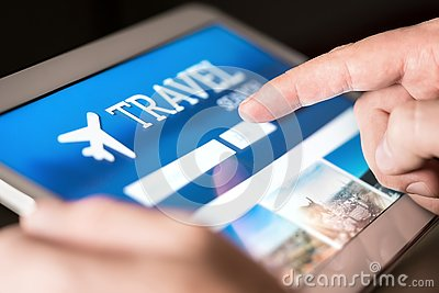 Travel search engine and website for holidays. Man using tablet to look for cheap flights and hotels.