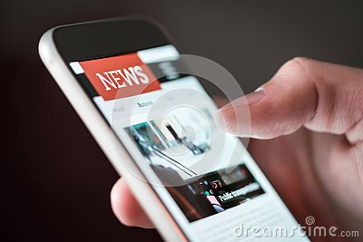 Mobile news application in smartphone. Man reading online news on website with cellphone.