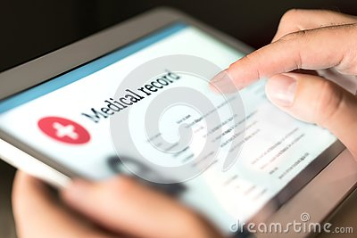Electronic medical record with patient data and health care information in tablet.