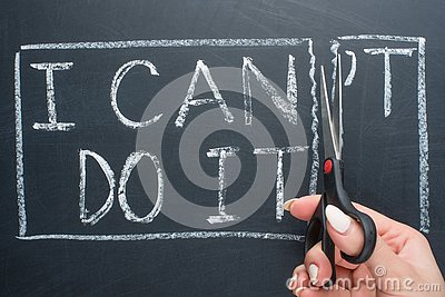 using scissors to remove the word can & x27;t to read I can do it concept for self belief, positive attitude and motivation