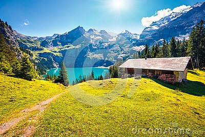 Colorful summer morning on the unique Oeschinensee Lake. Splendid outdoor scene in the Swiss Alps with Bluemlisalp mountain, Kande