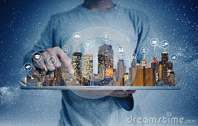 A man using digital tablet with building hologram and internet media icons. Smart city, 5g, internet and networking technology con