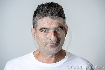 stock image of portrait of a mature 40s to 50s white angry and upset man looking furious and aggressive human emotions facial expressions and