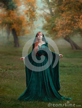 Runaway princess with red blond long hair dressed in a green emerald expensive velvet royal cloak-dress with a precious