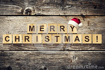 Merry Christmas. Words made up of alphabet on wooden cubes. Wooden background. Christmas background.