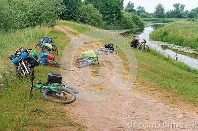 stock image of 11 june 2018, kaliningrad region, russia, travel by bicycle, bicycles near the river, bicycles with bags