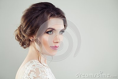 Beautiful female face. Young perfect woman with makeup and bridal hairdo, portrait
