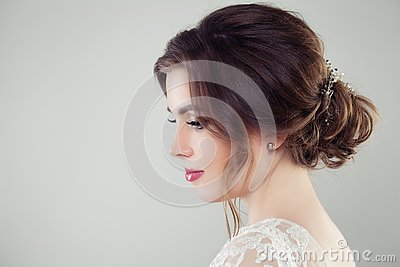 Pretty bride woman with bridal hair. Updo haircut with pearls hairdeco, face closeup